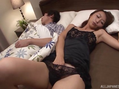 Asian babe gets her hairy cunt drilled next to her hibernating hubby