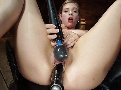 Unaccompanied babe uses huge fuck machine for own sexual delight