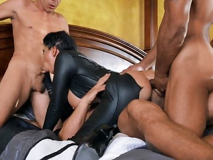 Busty brunette Romi Rain is haunted and fucked by three studs